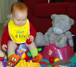 8 months - with ted on his potty