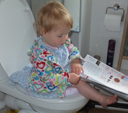 15 months - reading on the loo